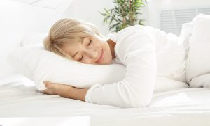 Beautiful woman sleeping in white bed